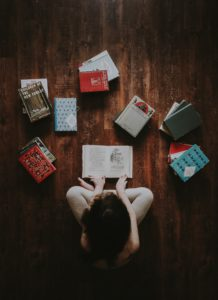 A woman sitting in front of many books