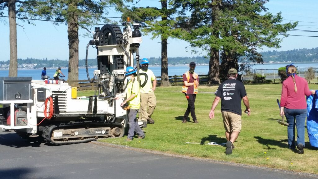 Equipment and people on lawn